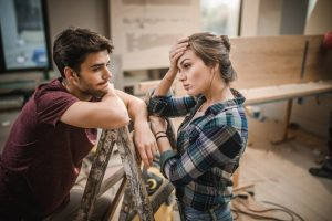 Young couple having problems while renovating their apartment.